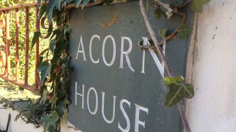 Medium crop acornhousesign