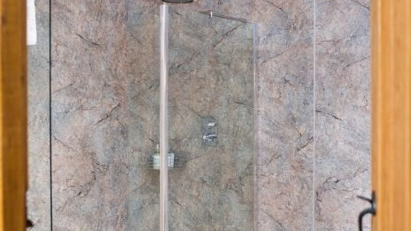 Medium crop shower in a battlesteads luxury lodge