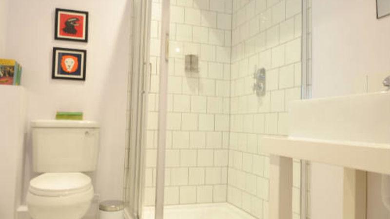 Medium crop reading bathroom