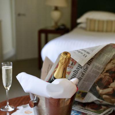 Thumb room drops filled glass champ   newspaper