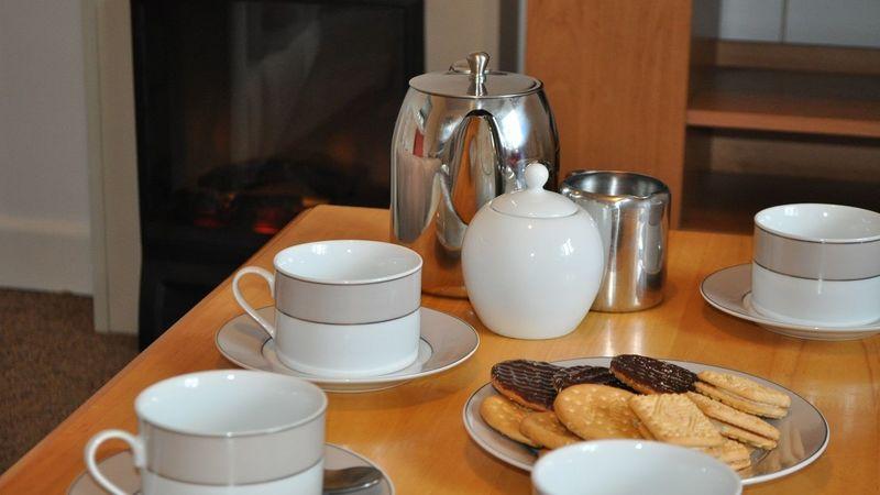 Medium crop weavers front room tea and biscuits