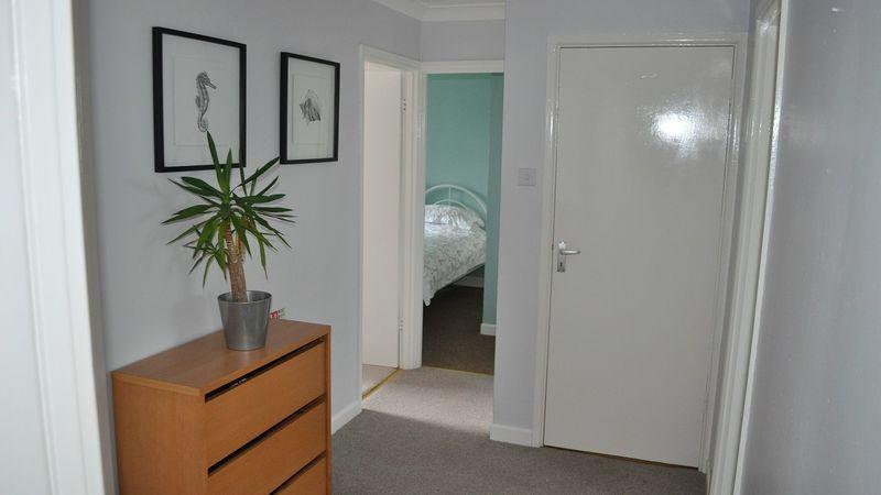 Medium crop weavers hallway to bedrooms