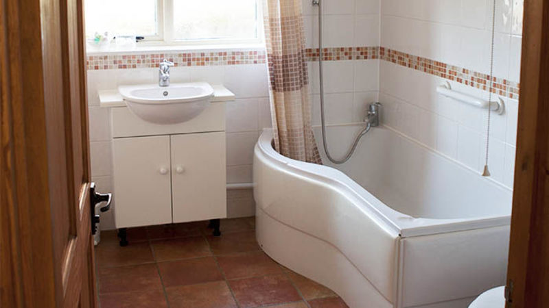 Medium crop coachman s cottage  bathroom