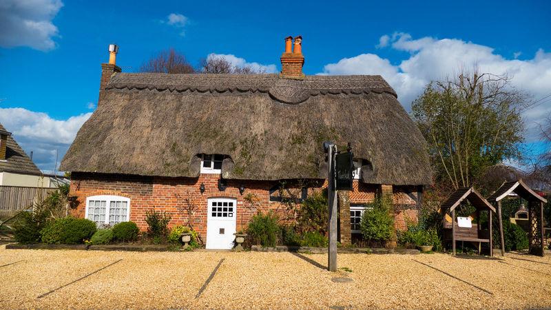 Medium crop thatched cottage front