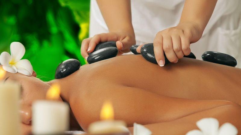 Medium crop hot stone massage