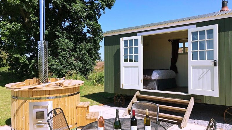 Medium crop exterior shepherds hut with hot tub